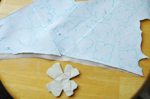 First I drew the flowers with washable marker and then cut them out, sewed them and turned them to make my own appliques.