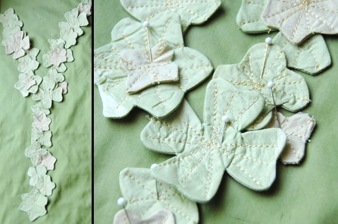 Here I pinned the appliques to a bolt of fabric to see how to lay them out on the dress.